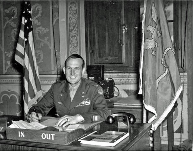 Colonel Monro MacCloskey, Commander of the 15th BG / 885th BS, at his desk. Pasquini castle, Castiglioncello, Italy. May 1945