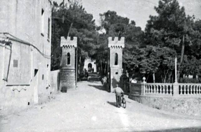 The guard post of the 15th BG / 885th & 859th BS HQ in a medieval setting, up an avenue of trees and statues. Pasquini Castle, Castiglioncello, Italy. April 1945.