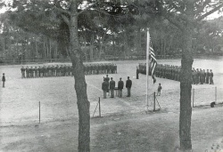 The 885th BS and 859th BS are assembled at the Parade Grounds, which doubled as a ball field, to receive the Presidential Unit Citation for the February 17th/18th mission. Officers are to the left in the photo, enlisted men on the right. Castiglioncello, Italy. April 1945.