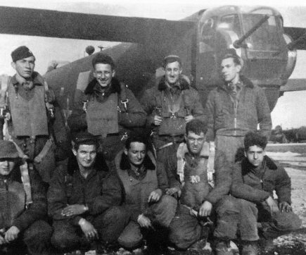 Top row, left to right: 1st Lt. Jim (Harvey) L'Hommedieu, bombardier; 1st Lt. Thomas Bonna, navigator; 2nd Lt. Paul Le Sieur, co-pilot; 1st Lt. Henry Loser, pilot. Bottom row, left to right: T/Sgt. Leonard Schiller, top-turret and flight engineer; S/Sgt. Andrew Babich, radio operator; S/Sgt. Clarence Block, waist gunner and dispatcher; Sgt. Benjamin Montgomery, waist gunner and dispatcher; Sgt. Ralph Cavaliere, tail gunner. The picture was taken before a day sortie at the hardstand of their B-24 Liberator #670 (X). Rosignano, Italy, April 1945.